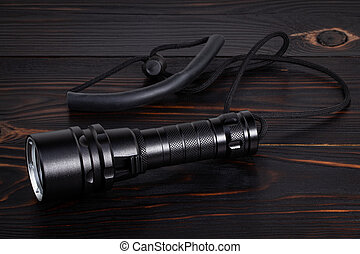 flashlight on wooden background with copy space