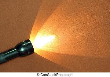 Flashlight - Modern aluminium luminous flashlight on ginger...