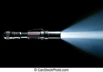 flashlight with beam of light - tactical police and military...