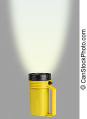Flashlight with Beam - Room for Text - A handheld flashlight...