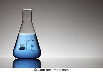 flask with blue liquid to the light and white background