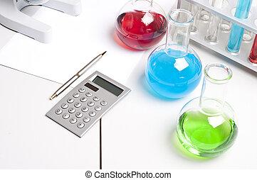 flasks, pen, calculator, workplace