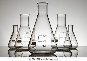 flasks - five empty flasks on a white backlight