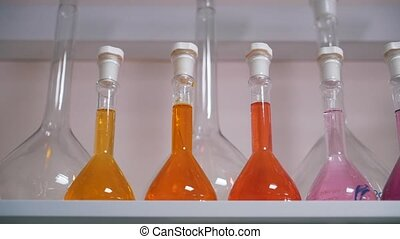 flasks with liquids in lab close up