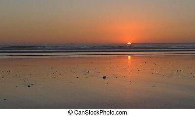 Flat beach at sunset