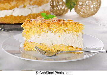 flat cake with an almond and sugar coating and a custard or...