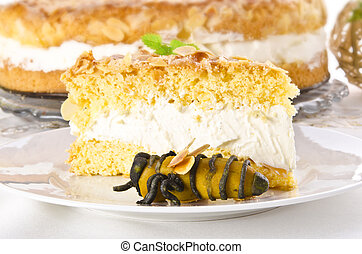 flat cake with an almond and sugar coating and a custard or cream filling
