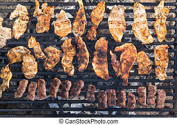 Flat lay above chicken white breast meat on the barbecue grill with kebabs