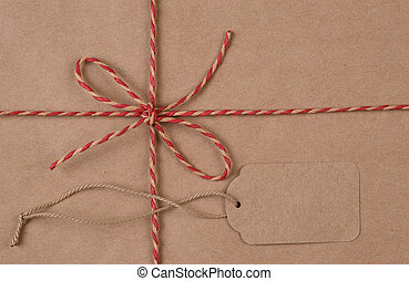 Flat Lay Brown shipping parcel tied with twine and tag for copy space