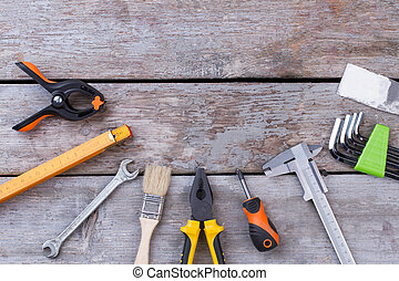 Flat lay carpenter tools on wooden background.
