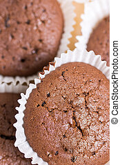 Flat lay chocolate cupcakes muffins on the plate