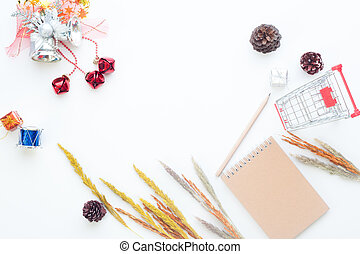 Flat lay Christmas and winter items with shopping cart on white background, Online shopping in winter