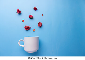 Flat lay coffee cup with flowers