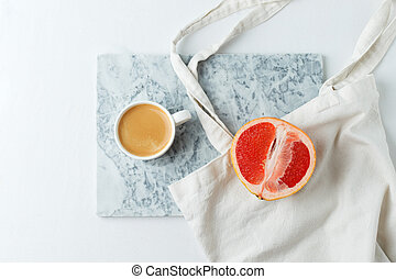 Flat lay coffee with eco craft tissue bag and grapefruit on ...