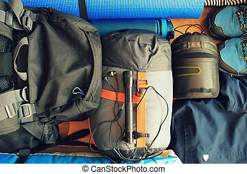 Flat lay composition with camping equipment on wooden background