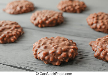 Flat lay composition with chocolate cookies on wooden background
