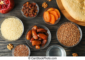 Flat lay composition with delicious food on wooden background
