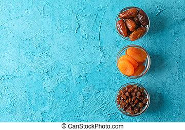Flat lay composition with Ramadan Kareem food on color...