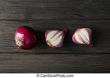 Flat lay composition with red onion on wooden background