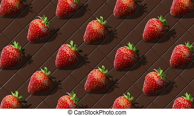 Beautiful background from  of large group of red juicy strawberries berries. Fresh juicy strawberry rotating on background of chocolate bar. Flat lay, top view. Isometric view. Seamless loop video.