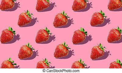 Beautiful background from  of large group of red juicy strawberries berries. Fresh juicy strawberry rotating on pink background. Flat lay, top view. Isometric view. Seamless loop video.