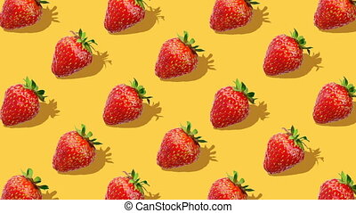 Beautiful background from  of large group of red juicy strawberries berries. Fresh juicy strawberry rotating on yellow background. Flat lay, top view. Isometric view. Seamless loop video.
