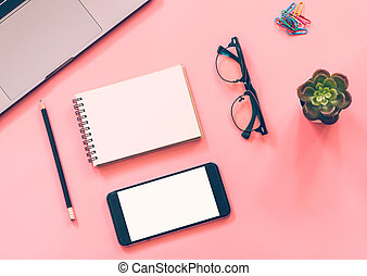 Flat lay design of workspace desk with laptop, blank notebook, smartphone, pencil, stationery with copy space background