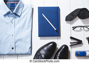 Flat lay fashion set of businessman accessories, top view on white wooden background