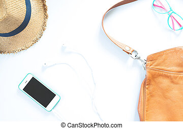 Flat lay female accessories collage with hat, bag, fashion glasses, mobile phone and earphone on white background.