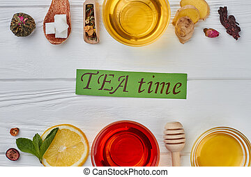 Flat lay healthy tea composition on wooden background.