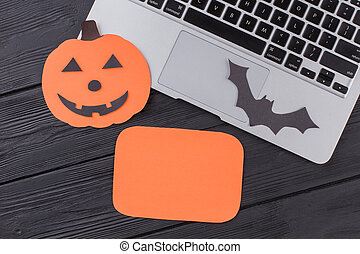 Flat lay laptop pc with halloween attributes and copy space.