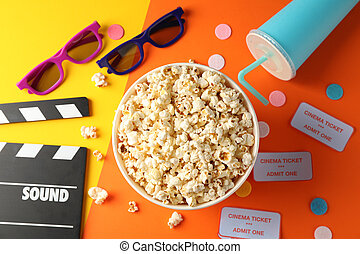 Flat lay. Movie watch accessories on two tone background, top view
