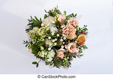 Flat lay of a beautiful florish bouquet composition on the white background