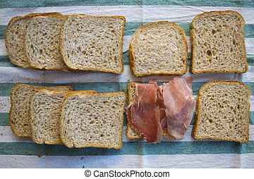 flat lay of a sandwich with cured ham