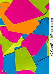 Flat lay of abstract colored paper and pastel paper background. Colorful bright paper texture. Geometrical composition. Pink, green, blue,