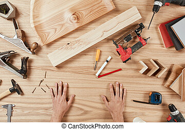 Flat lay of carpenter s tools on wooden background