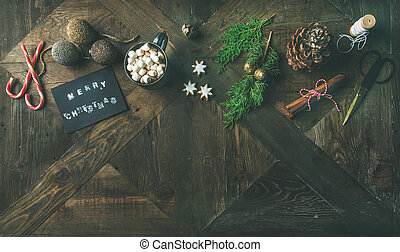 Flat-lay of greeting card, glittering toys, hot chocolate,...