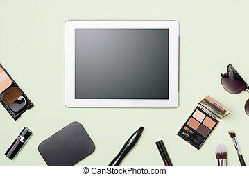 Flat lay of make up cosmetic products with digital tablet on light color background