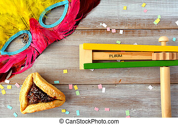 Flat lay of Purim Jewish holiday food and objects:...
