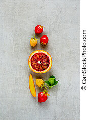 fr - Flat-lay of resh fruits and berries on light...