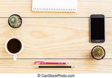Flat lay office desk with notebooks, smart phone, pen and a cup of coffee.