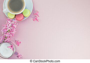 Flat lay photo of coffee cup with flowers