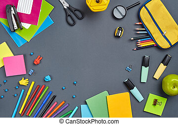 Flat lay photo of workspace desk with school accessories or office supplies.