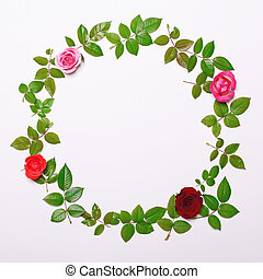 Flat lay - Round frame made of beautiful fresh roses and leaves