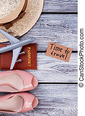 Flat lay traveler accessories on wooden background.