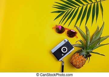 Flat lay traveler accessories on yellow background. Top view travel or vacation concept.