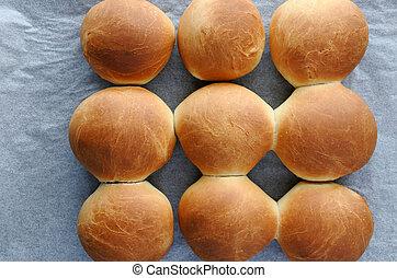 Flat lay view of fresh bread rolls