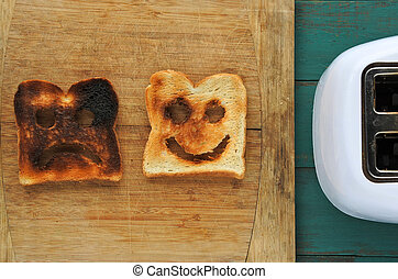 Flat lay view of two slices of toasted bread on a wooden ...