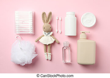 Flat lay with baby hygiene accessories on pink background