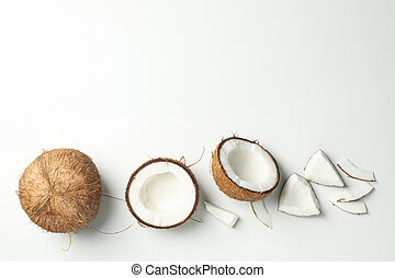 Flat lay with coconut on white background, top view